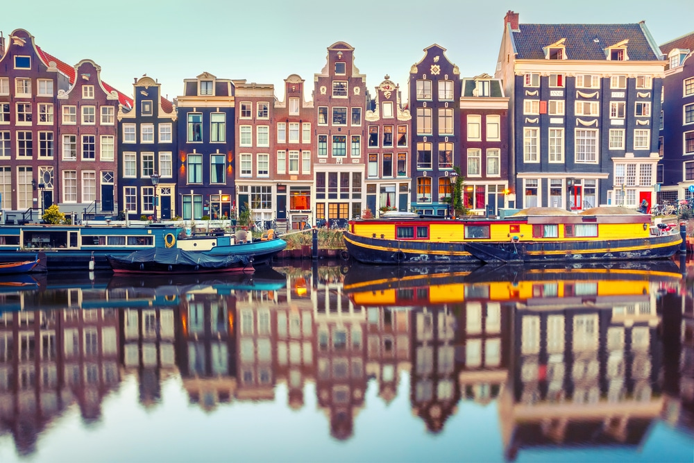 "Study and work in Amsterdam! Image from <span style=""font-weight: 400;""><a href=""https://www.netherlands-tourism.com/wp-content/uploads/2019/02/ccimage-shutterstock_534783616.jpg"">here</a>. </span>"